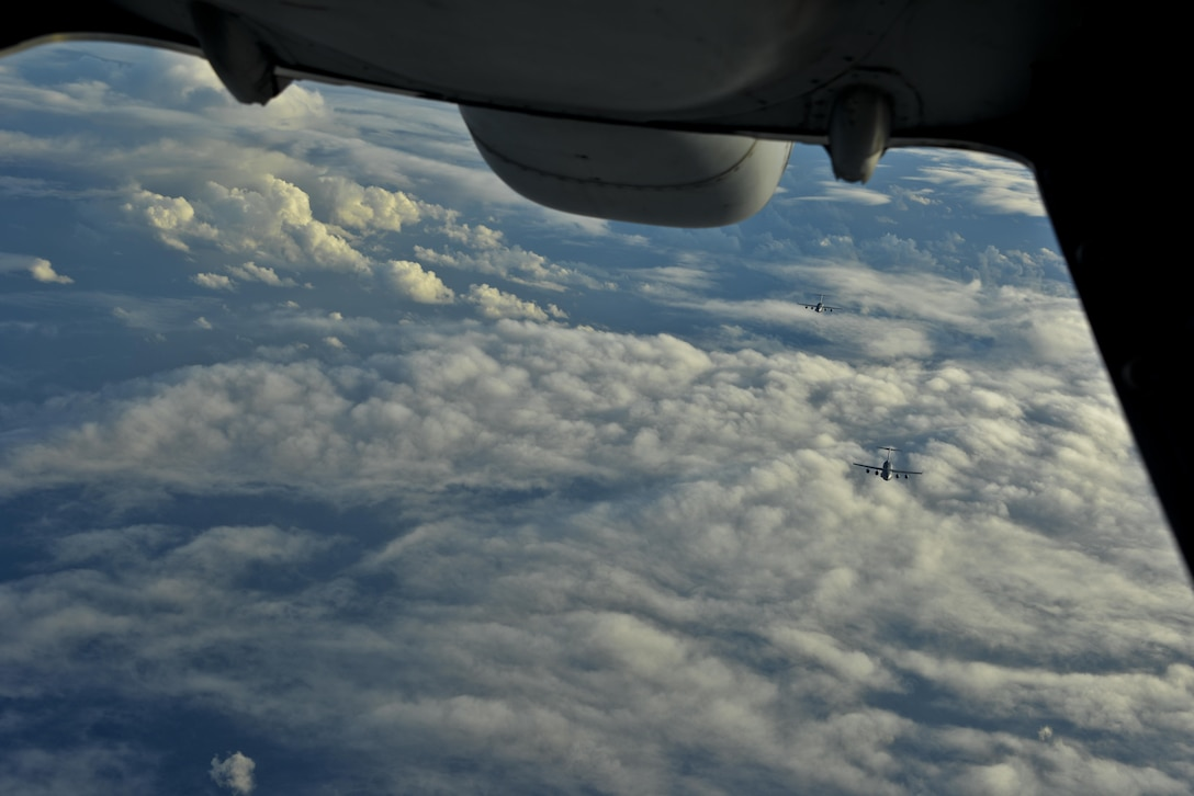 Two C-17 Globemaster IIIs approach a KC-10 Extender from Travis Air Force Base, California, in formation for air refueling over the Pacific Ocean during Exercise Ultimate Reach July 13, 2017. During the operation, three KC-10s from Travis AFB and Joint Base McGuire-Dix-Lakehurst, New Jersey, refueled five C-17s carrying more than 300 coalition paratroopers. The C-17s went on to conduct a strategic air drop over Australia in support of Exercise Talisman Saber 2017. (U.S. Air Force photo by 2nd Lt. Sarah Johnson)