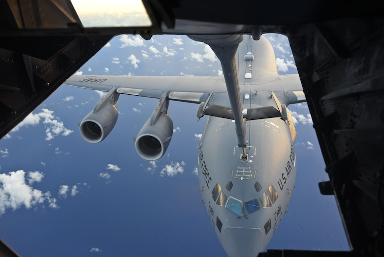 A KC-10 Extender from Travis Air Force Base, California, refuels a C-17 Globemaster III over the Pacific during Exercise Ultimate Reach July 13, 2017. During the operation, three KC-10s from Travis AFB and Joint Base McGuire-Dix-Lakehurst, New Jersey, refueled five C-17s carrying more than 300 coalition paratroopers. The C-17s went on to conduct a strategic air drop over Australia in support of Exercise Talisman Saber 2017. (U.S. Air Force photo / 2nd Lt. Sarah Johnson)
