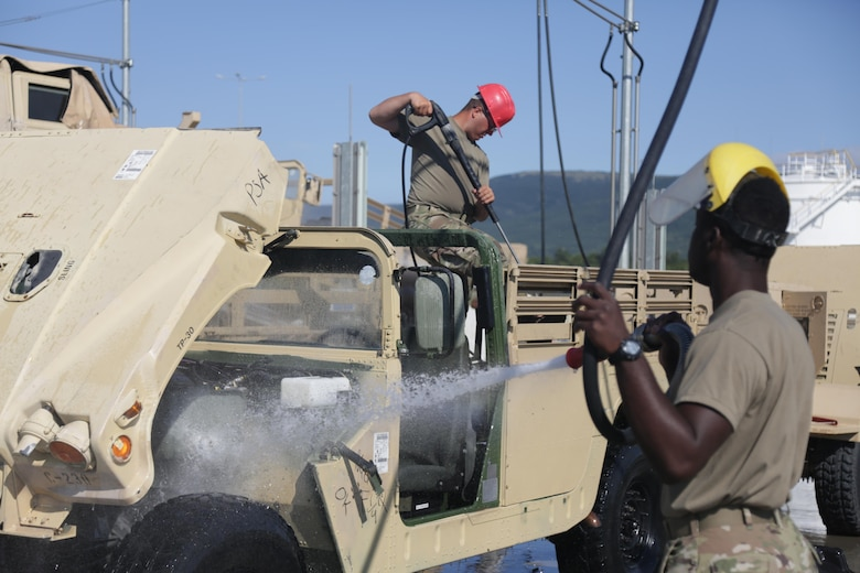 Soldiers from the 86th Expeditionary Signal Battalion wash trucks and equipment, July 14, at the wash rack on Novo Selo Training Area in Bulgaria. Logistical support for the wash facility is maintained by the Black Sea Area Support Team. The BSAST oversees and executes all aspects of operational and strategic operations for NSTA and the Mihail Kolgalniceanu Airbase in Romania.