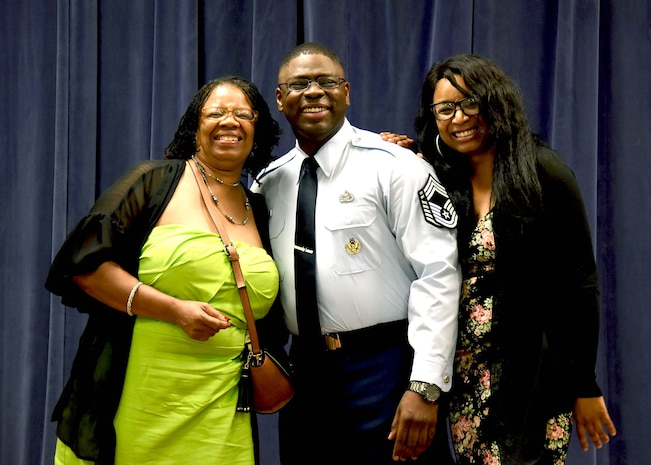 NEW CASTLE AIR NATIONAL BASE, Del.- Delaware Air National Guard's newest Chief Master Sergeant, Chief Robbie Hunt takes a photo with his mother, Karen Hunt-Sims, and his sister, Corea Nimmons, right, and after his is tacked on with E-9 Chevrons during a promotion ceremony held in his honor on July 15, 2017.  (U.S. Air National Guard photo by TSgt Gwendolyn Blakley/Released).