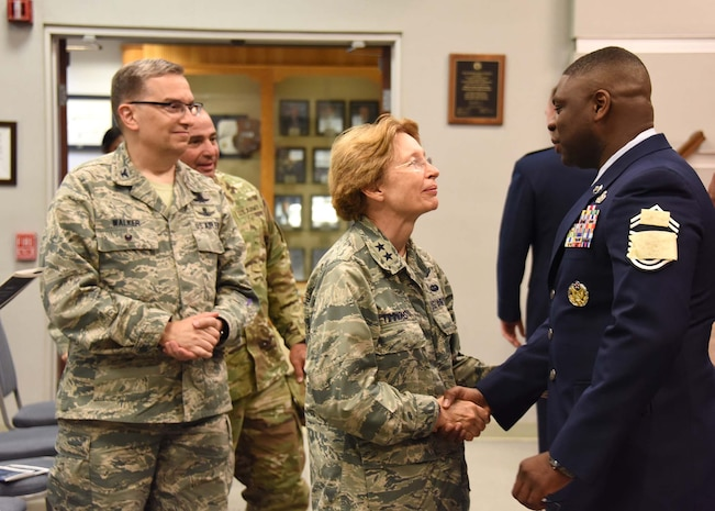 NEW CASTLE AIR NATIONAL GUARD BASE, Del. – Major Gen. Carol. A. Timmons, adjutant general, Delaware National Guard, center, and Col. David Walker, assistant adjutant general-Air, Delaware National Guard, left, congratulate Delaware Air National Guard's newest Chief Master Sergeant, Chief Robbie Hunt, left, following a promotion ceremony held on July 15, 2017. (U.S. Air National Guard photo by TSgt Gwendolyn Blakley/ Released).