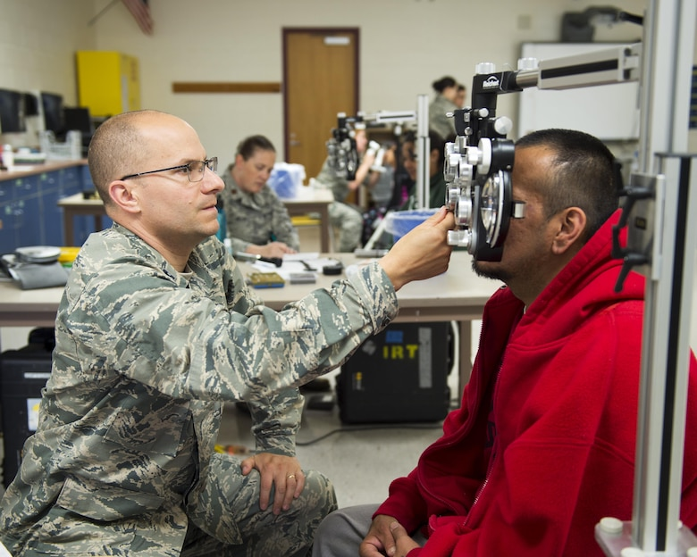 """U.S. Air Force airmen from the 133rd and 148th Medical Group, Minnesota Air National Guard, partner with reservists from around the country to provide medical care services during Innovative Readiness Training at Cass Lake-Bena High School in Cass Lake, Minn., July 13, 2017. The IRT at Cass Lake is a multi-service medical mission that provides military members with """"hands-on"""" training opportunities, while at the same time providing medical care services to the local community. (U.S. Air National Guard photo by Tech. Sgt. Austen R. Adriaens/Released)"""