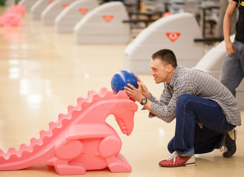"""Maj. Rob """"DX"""" Engelmann, 860th Network Operations Squadron director of operations, practices cyber tactics, techniques and procedures using bowling precision using the dinosaur strategy. The unit will soon say farewell to Engelmann, who's served as one of the unit's founding members. (Courtesy photo)"""