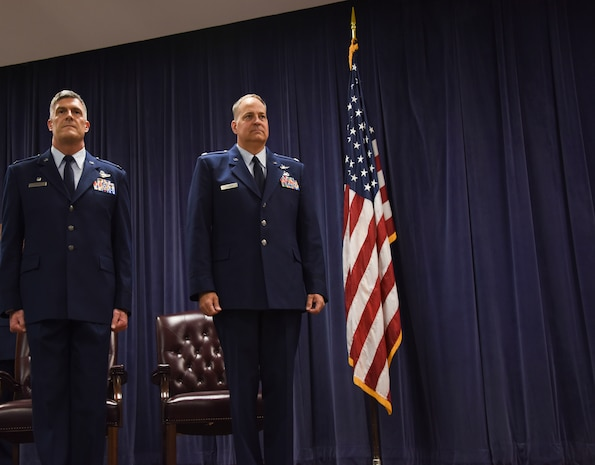 NEW CASTLE AIR NATIONAL GUARD BASE, Del- Col. Robert Culcasi, commander, 166th Airlift Wing, left, and Lt. Col. Trevor Fulmer, vice commander, 166th Airlift Wing, await for the promotion order to be published during a ceremony on July 14, 2017. Fulmer was promoted to Colonel; members of the Delaware National Guard were present to commemorate this achievement. (U.S. Air National Guard photo by Staff Sgt. Alonzo Chapman/ Released).