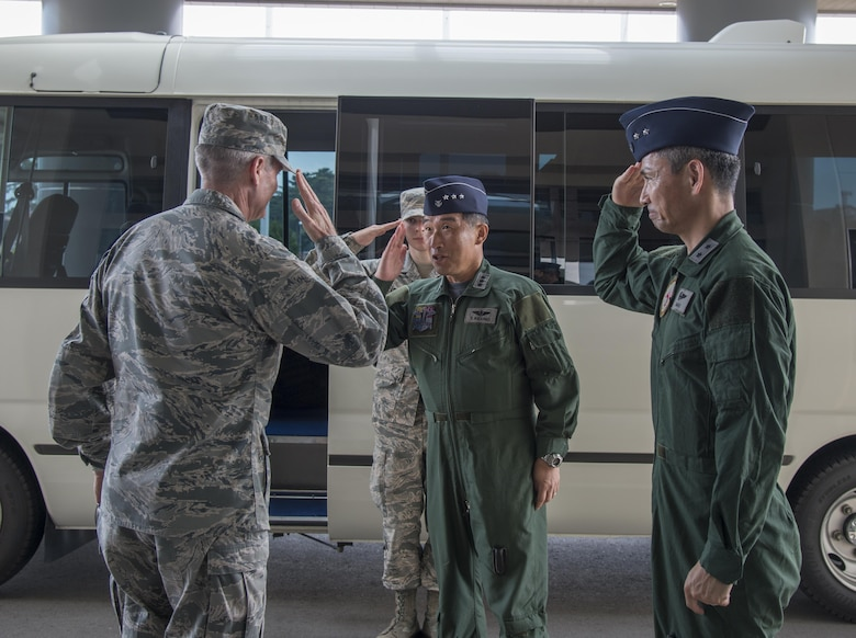 U.S. Air Force Lt. Gen. Darryl Roberson, commander, Air Education and Training Command, salutes Koku-Jieitai Lt. Gen.Tamotsu Kindono, Northern Air Defense Force commander, and Maj. Gen. Koji Imaki, 3rd Air Wing commander, at Misawa Air Base, Japan, July 11, 2017. Roberson visited the 3rd AW to view the F-35-A Lightning II infrastructure build-up and to ensure continued AETC support of combined training efforts. This year, 10 Japan Air Self-Defense Force student pilots earned their wings from undergraduate pilot training at Luke Air Force Base, Ariz. (U.S. Air Force photo by Senior Airman Brittany A. Chase)