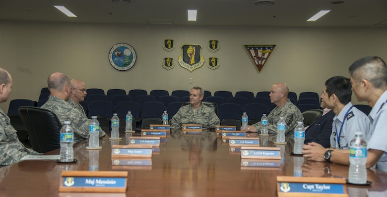 U.S. Air Force Lt. Gen. Darryl Roberson, commander, Air Education and Training Command, and AETC Command Chief Master Sgt. David Staton listen to a mission brief given by Col. R. Scott Jobe, 35th Fighter Wing commander, during their visit to Misawa Air Base, Japan, July 11, 2017. During the visit, the senior leaders were able to take a closer look at training to ensure continued support to 35th Fighter Wing maintainers. (U.S. Air Force photo by Senior Airman Brittany A. Chase)