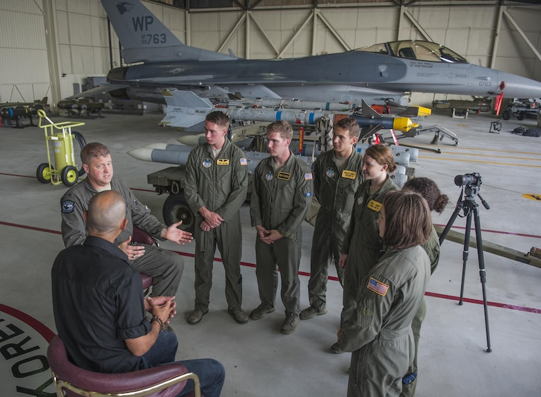 U.S. Air Force Academy Cadets discuss the role of public communications in the Air Force with Col. David Shoemaker, 8th Fighter Wing commander and Vladimir Duthiers, CBS correspondent July 10, 2017, at Kunsan Air Base, Republic of Korea. The cadets had the opportunity to sit in and listen to an interview between Shoemaker and Duthiers as a part of their two and a half week immersion program, known as Operations Air Force. (U.S. Air Force photo by Senior Airman Colville McFee/Released)