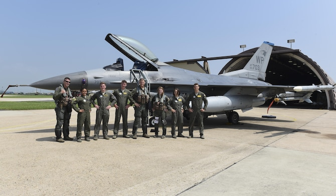 U.S. Air Force Col. David Shoemaker, 8th Fighter Wing commander, poses with U.S. Air Force Academy cadets at Kunsan Air Base, Republic of Korea, July 12, 2017. The visit was part of the Air Force Academy's Operation Air Force career immersion program. During the course of approximately two weeks between their sophomore and junior years, cadets from the Academy visit bases around the Air Force to develop their knowledge of potential jobs they can apply for and the service writ large. (U.S. Air Force photo by Senior Airman Michael Hunsaker/Released)