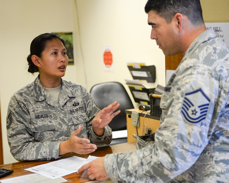 U.S. Air Force Technical Sgt. Ma Riolette Hidalgo, military pay technician assigned to the 379th Expeditionary Comptroller Squadron, Financial Services Flight, assists a customer at Al Udeid, Air Base, Qatar, May 24, 2017. The FMF assists deployed military members with travel pay, military pay and dispersal of funds. (U.S. Air National Guard photo by Tech. Sgt. Bradly A. Schneider/Released)