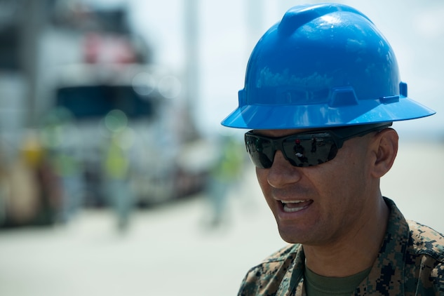 Master Sgt. Victor Garcia, the operations chief of Henoko Ammunitions Supply Point, speaks with Marines while conducting a movement of unserviceable ammunition, July 11, 2017, from the Ammunition Supply Point on Camp Schwab, Okinawa, Japan to a United States Naval Ship at Tengan Pier, Okinawa, Japan. The Marines with Ammunition Company, 3d Supply Battalion, Combat Logistics Regiment 35, 3d Marine Logistics Group, III Marine Expeditionary Force loaded up approximately 130 pallets of ammunition at the ASP to be transported and returned to the Naval Munitions Command on Sasebo Navy Base, Japan, for proper disposal. The experience of a ship-to-shore ammo movement is unique to the Marines with III MEF and benefits their forward deployed capabilities by simulating a realistic scenario that could happen during an operation.