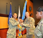 Navy Rear Adm. Vincent Griffith (left), then DLA Director of Logistics Operations, passes the flag to the new DLA CENTCOM & SOCOM commander, Army Col. Archie Herndon, at MacDill Air Force Base, Florida, July 7.