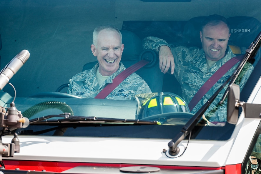 (Left) Chief Master Sgt. Alan Boling, Eighth Air Force command chief, operates a fire truck with Chief Master Sgt. Paul Elliott, 5th Bomb Wing command chief, at Minot Air Force Base, N.D., July 10, 2017. Boling visited base and spoke with 5th Civil Engineer Squadron firefighters about the critical role of front-line supervisors in Air Force Global Strike Command's deterrence mission. (U.S. Air Force photo/Senior Airman J.T. Armstrong)