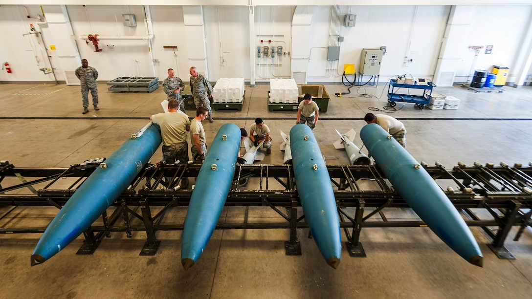 Airmen from the 5th Munitions Squadron build inert GBU-31 bombs at Minot Air Force Base, N.D., July 11, 2017. After the build, Chief Master Sgt. Alan Boling, Eighth Air Force command chief, spoke with 5 MUNS Airmen about the critical role of front-line supervisors in Air Force Global Strike Command's deterrence mission. (U.S. Air Force photo/Senior Airman J.T. Armstrong)