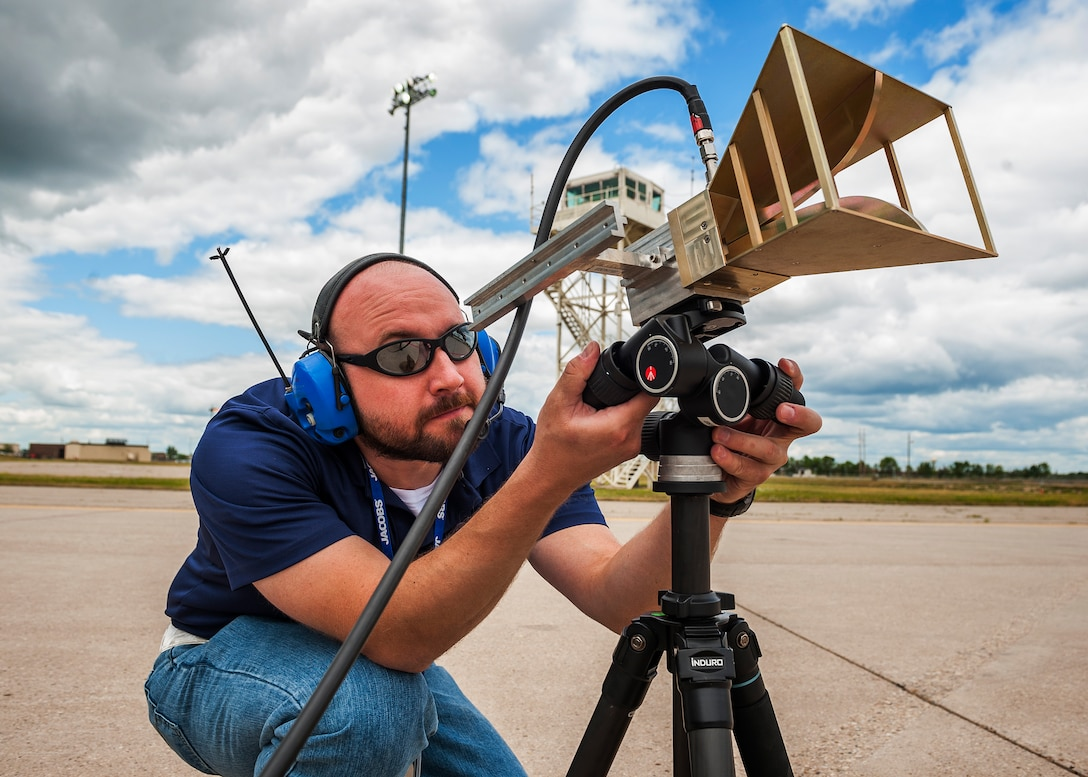 Rein Haas, 16th Electronic Warfare Squadron test engineer, directs a horn antenna during Combat Shield at Minot Air Force Base, N.D., July 12, 2017. The antenna is used for transmitting radio frequencies that are received and analyzed by the electronic warfare officer inside an aircraft. (U.S. Air Force photo/Senior Airman J.T. Armstrong)