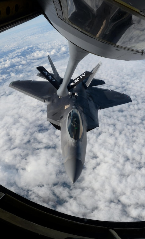 A U.S. Air Force F-22 Raptor, assigned to the Air Combat Command F-22 Demonstration Team at Langley Air Force Base, Virginia, receives fuel from a 100th Air Refueling Wing KC-135 Stratotanker, July 14, 2017, over France. The F-22 demo team performs precision aerial maneuvers to demonstrate the capabilities of the Air Force's newest fighter aircraft. (U.S. Air Force photo by Senior Airman Justine Rho)