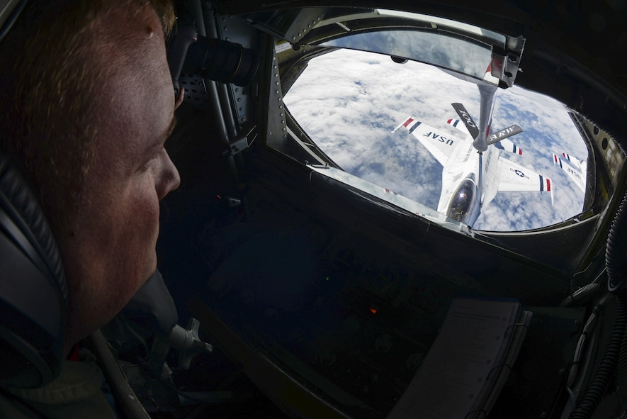 U.S. Air Force Senior Airman Joseph Wukasch, 351st Air Refueling Squadron boom operator, operates the boom July 14, 2017, to provide air refueling for a U.S. Air Force Thunderbird over France. The Thunderbirds were on their way to the 2017 Royal International Air Tattoo airshow at RAF Fairford, England, after performing flyovers at Bastille Day in Paris. (U.S. Air Force photo by Senior Airman Justine Rho)