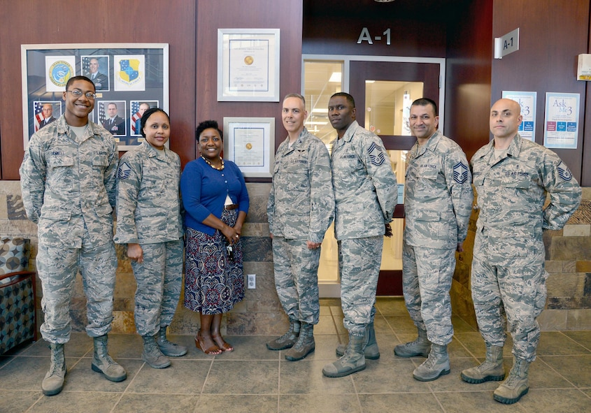 Airman 1st Class Jason Pannell, with the 72nd Medical Support Squadron; Master Sgt. Nonika Allen, with the 72nd Dental Squadron; Michaelle Gordon, Clinical Care and Risk Management officer; 72nd Medical Group Commander Col. Christopher Grussendorf; Chief Master Sgt. Paul Thomas, 72nd MDG superintendent; Senior Master Sgt. Manny Suprai, with the 72nd Medical Operations Squadron and Master Sgt. Brian Yannarelli, with the 72nd MDSS, surround a new certificate which hangs in the front lobby of the Tinker Clinic. The certificate is from The Joint commission, bestowing a three-year accreditation to the 72nd Medical Group by meeting the requirements for the Ambulatory Health Care Accreditation Program. Airman Pannell served as support staff during the Med Group's recent inspection; Sergeants Allen, Yannarelli and Suprai served as pre-surveyors; and Ms. Gordon led her team to the distinguished accomplishment. (Air Force photo by Kelly White)