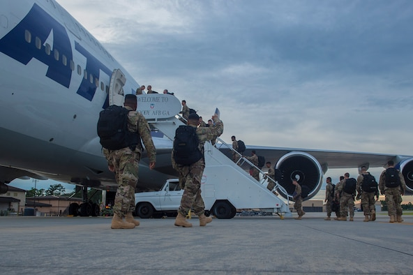 Moody Airmen board a Boeing 747 prior to deploying, July 10, 2017, at Moody Air Force Base, Ga. More than 300 Airmen deployed to Southwest Asia to aid the 74th Fighter Squadron's A-10C Thunderbolt II mission in support of Operation Inherent Resolve. (U.S. Air Force photo by Senior Airman Greg Nash)