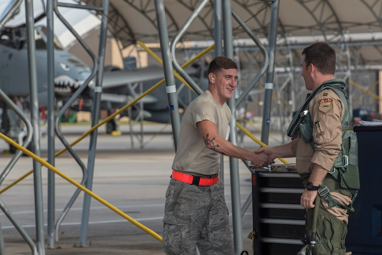 Senior Airman Cody Pennington, 476th Maintenance Squadron crew chief, left, greets Capt. Thomas Ainscough, 74th Fighter Squadron A-10C Thunderbolt II pilot, prior to deploying, July 11, 2017, at Moody Air Force Base, Ga. More than 300 Airmen deployed to Southwest Asia to aid the 74th Fighter Squadron's A-10 mission in support of Operation Inherent Resolve. (U.S. Air Force photo by Senior Airman Greg Nash)