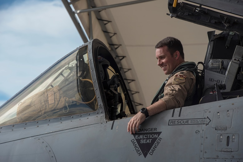 Capt. Thomas Ainscough, 74th Fighter Squadron A-10C Thunderbolt II pilot, smiles during a pre-flight inspection prior to deploying, July 11, 2017, at Moody Air Force Base, Ga. More than 300 Airmen deployed to Southwest Asia to aid the 74th Fighter Squadron's A-10 mission in support of Operation Inherent Resolve. (U.S. Air Force photo by Senior Airman Greg Nash)