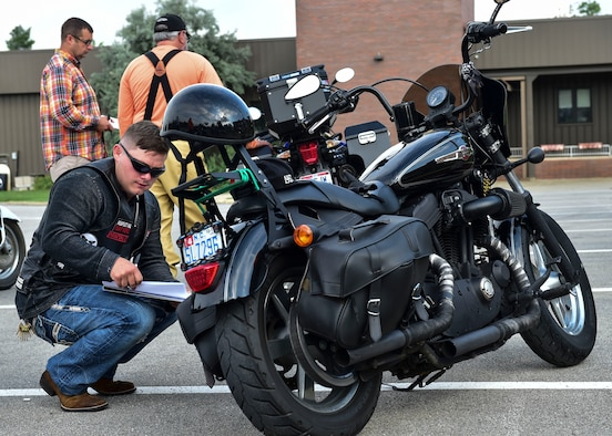 U.S. Marine Corps Staff Sgt. Mitchell Thompson, the logistics chief assigned to Detachment 3, Maintenance Company, inspects his motorcycle during a motorcycle safety course July 14, 2017, here. Regularly inspecting your motorcycle is a critical first step to motorcycle safety. (U.S. Air Force Photo/Senior Airman Jeffrey Grossi)
