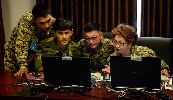 Exercise participants collaborate on a mission plan during multinational exercise Regional Cooperation 2017, July 14, 2017, in Dushanbe, Tajikistan. Regional Cooperation has been conducted annually since 2001; the last exercise was held Sept. 16-28, 2016, in Cape Cod, Massachusetts. (U.S. Air Force photo by Staff Sgt. Michael Battles)