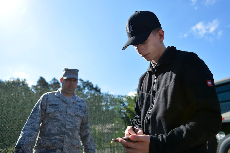 Felix Myer, 435th Construction and Training Squadron, administrative service clerk apprentice, writes down vehicle parts for purchase, on Ramstein Air Base, Germany, Jul. 13, 2017. The 435th CTS is conducting an apprenticeship training program for local national youth. (U.S. Air Force photo by Airman 1st Class Joshua Magbanua)