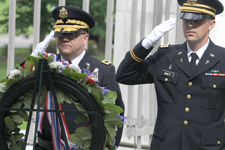 Brigadier General Stephen E. Strand, deputy commanding general for the U.S. Army Reserve's 88th Regional Support Command, and Chaplain (Capt.) Timothy Wilmetti, chaplain for the 489th Civil Affairs Battalion, render honors during the playing of Taps after placing a wreath at the tomb for the 29th President of the United States Warren G. Harding during a ceremony in Marion, Ohio, July 15.