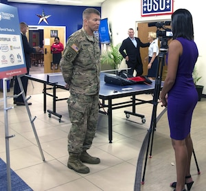 Lt. Gen. Jeffrey Buchanan (left), U.S. Army North (Fifth Army) commanding general, is interviewed by a reporter from a local television station during the transition summit and job fair at the Fort Sam Houston Community Center at Joint Base San Antonio-Fort Sam Houston July 13.
