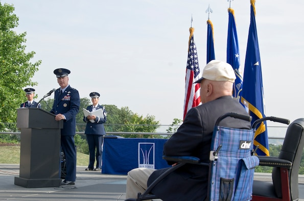 Maj. Gen. James A. Jacobson (standing at podium), Air Force District of Washington commander, delivers remarks at a Purple Heart award ceremony July 14, 2017 at the U.S. Air Force Memorial, Arlington, Va. The award was approved for World War II veteran Lt. Pedevillano (right) 72 years after he was liberated from a German prisoner of war camp by Gen. George S. Patton, Jr.'s 3rd U.S. Army. (Air Force photo by Staff Sgt. Joe Yanik)