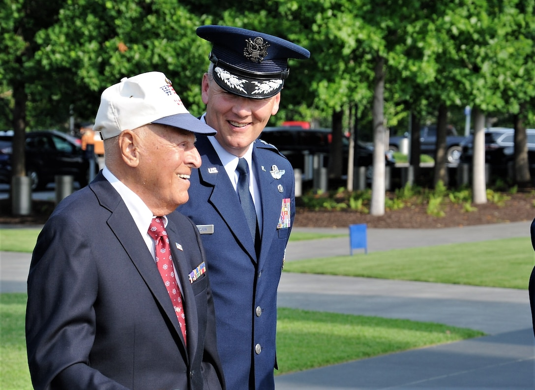 Maj. Gen. James A. Jacobson (right), Air Force District of Washington commander, walks beside World War II veteran, Lt. John Pedevillano, at the beginning of a Purple Heart award presentation ceremony July 14, 2017 at the U.S. Air Force Memorial, Arlington, Va. According to his family, even while injured, Pedevillano saved the lives of his badly-wounded waist gunners by securing their parachutes, pushing them out the side windows and pulling their cords. (Air Force photo by Staff Sgt. Joe Yanik)