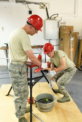 219th RED HORSE Squadron Water and Fuel System Management Apprentice Airman 1st Class Austin Furr and his father, 219th RHS Senior Enlisted Leader Chief Master Sgt. Brian Furr, thread pipe manually while supporting Exercise Related Construction June 14, 2017 in Postonja, Slovenia. The exercise will aid Exercise Immediate Response to occur later this year. This is the first time the father and son have deployed together. (U.S. Air National Guard photo by Staff Sgt. Lindsey Soulsby)