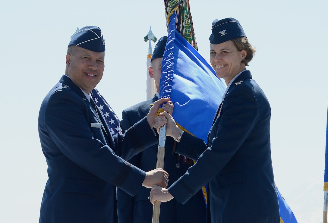 Col. Rebecca Sonkiss (right), 62nd Airlift Wing commander, accepts the 62nd AW guidon from Lt. Gen. Giovanni Tuck (left), 18th Air Force commander, during a change of command ceremony July 14, 2017, at Joint Base Lewis-McChord, Wash. Sonkiss is the former vice wing commander of the 455th Air Expeditionary Wing. Bagram Air Field, Afghanistan. (U.S. Air Force photo/Staff Sgt. Divine Cox)