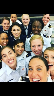 2nd Lt. Taylor Parker, 10th Missile Squadron missileer, center, takes a selfie with her teammates during the Armed Forces Volleyball Tournament. Parker, was one out of 12 women selected from three military teams to move on to play for the Armed Forces game.  (Courtesy photo)