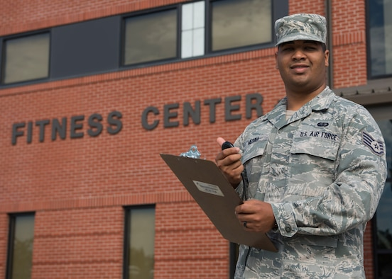 SSgt. Miguel Medina, 92nd Force Support Squadron fitness journeyman, poses in front of the base Fitness Center July 7, 2017, at Fairchild Air Force Base, Washington. Medina is the supervisor of the Physical Fitness Testing program for the base. (U.S. Air Force photo / Airman 1st Class Ryan Lackey)