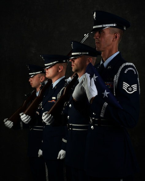 Staff Sgt. Michael J. Solo, 5th Force Support Squadron NCOIC of the base honor guard, poses with his honor guardsmen at Minot Air Force Base, N.D., June 26, 2017. The honor guard attends many ceremonies, to include colors team sequences with both flags and rifles, funeral sequences, pallbearing, firing party, flag folding, sword cordons and other ceremonies. (U.S. Air Force photo by Airman 1st Class Dillon J. Audit)
