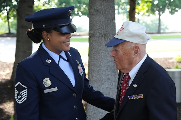 """Master Sgt. Tamekia Wood, U.S.Air Force Honor Guard, assists  2nd Lt. (Ret.) John Pedevillano before his  Purple Heart award ceremony on July 14, 2017 at the U.S. Air Force Memorial, Arlington, Va.  Maj. Gen. James A. Jacobson, Air Force District of Washington commander, hosted the Purple Heart award ceremony and presented the prestigious award to 2nd Lt. (Ret.) John Pedevillano for wounds he incurred during a forced march as a World War II prisoner of war in Germany. Pedevillano, a B-17 bombardier pilot, and his crew assigned to the 306th Bomb Group of the """"Mighty Eighth"""" Air Force were shot down during a bombing mission in airspace over Nazi Germany on April 24, 1944.  Per U.S. Army regulation, 600-8-22 Ch. 2, Par. 8, the Purple Heart is awarded in the name of the President of the United States to any member of the U.S. Armed Forces who, after April 5, 1917, has been wounded, killed, or has died from wounds while serving under competent authority in any capacity with one of the U.S. Armed Services. (U.S. Air Force Photo by Mr. James E. Lotz/)(Released)"""