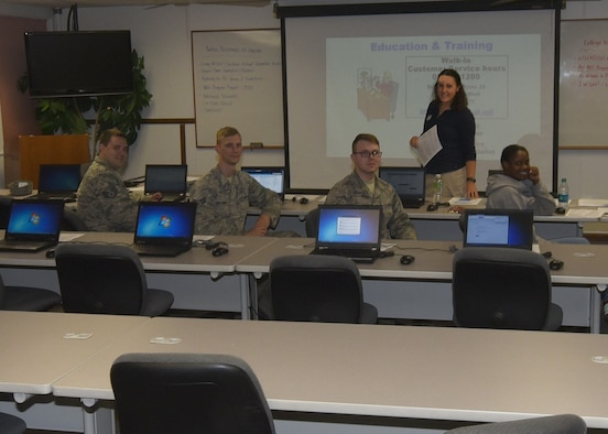 Members of the Mighty Ninety attend a tuition assistance briefing hosted by Coryn Davis, Community College of the Air Force advisor at F.E. Warren Air Force Base, Wyo., July 13, 2017. The briefing is just one resource that is available when you visit the Education and Training Center. (U.S. Air Force photo by Terry Higgins)