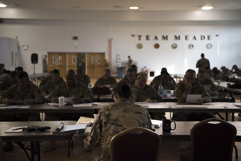 """Command Sgt. Maj. Ted L. Copeland, command sergeant major of the Army Reserve, speaks to leadership from the 200th Military Police Command and its subordinate units during a conference at McGill Training Center at Fort Meade, Maryland, July 15, 2017. Joining Copeland is Command Sgt. Maj. Craig Owens, the command sergeant major for the 200th MP Command. The command hosted a Quarterly Training Briefing conference at Fort Meade from July 15-17, to strategize on future needs, and how they support the U.S. Army Reserve Command's focus on combat readiness. Owens reminded the leadership to """"focus on training as a unit, a team. It's the team that goes to war and wins."""" (U.S. Army Reserve Photo by Sgt. Audrey Hayes)"""
