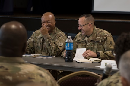 "Command Sgt. Maj. Ted L. Copeland, command sergeant major of the Army Reserve, speaks to leadership from the 200th Military Police Command and its subordinate units during a conference at McGill Training Center at Fort Meade, Maryland, July 15, 2017. Joining Copeland is Command Sgt. Maj. Craig Owens, the command sergeant major for the 200th MP Command. The command hosted a Quarterly Training Briefing conference at Fort Meade from July 15-17, to strategize on future needs, and how they support the U.S. Army Reserve Command's focus on combat readiness. Owens reminded the leadership to ""focus on training as a unit, a team. It's the team that goes to war and wins."" (U.S. Army Reserve Photo by Sgt. Audrey Hayes)"