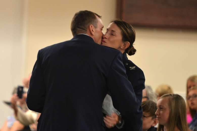 U.S. Air Force Col. Dustin P. Smith, Headquarters U.S. Air Forces Central Command chief of staff, thanks his wife, Col. Kristine B. Smith, 710th Combat Operations Squadron deputy director from Joint Base Langley-Eustis, Va., at the end of his retirement ceremony, July 14, 2017, Shaw Air Force Base, S.C. The former USAFCENT chief of staff retired after 26 years of service. (U.S. Air Force photo by Senior Airman Christopher Maldonado)