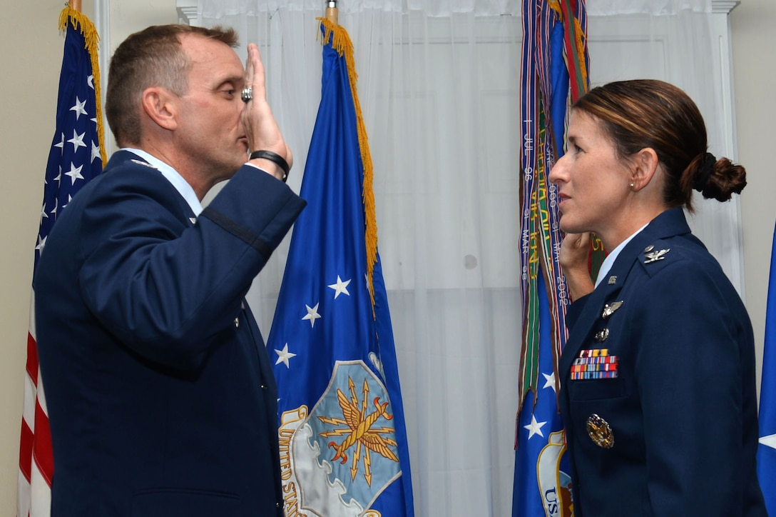 U.S. Air Force Col. Dustin P. Smith, Headquarters U.S. Air Forces Central Command chief of staff, promotes Col. Kristine B. Smith, 710th Combat Operations Squadron deputy director from Joint Base Langley-Eustis, Va., July 14, 2017, Shaw Air Force Base, S.C. The former USAFCENT chief of staff promoted his wife as his last official duty in the Air Force before retirement. (U.S. Air Force photo by Senior Airman Christopher Maldonado)