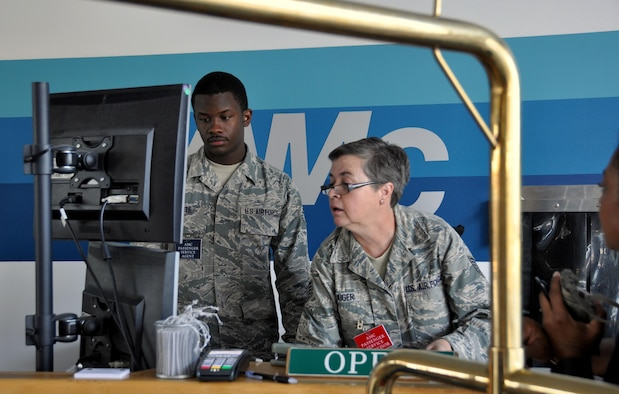 Senior Airman Marquise White and Tech. Sgt. Renee Kiger, Air Transportation Journeymen with Joint Base Charleston's 81st Aerial Port Squadron, process passenger luggage and tickets at Ramstein Air Base's passenger terminal, July 13, 2017. White and Kiger are responsible for ensuring that passengers and their baggage are safely processed to departing aircraft.  Reservists from JB Charleston trained at Ramstein in July 2017 to help stay ready for any upcoming deployments. (U.S. Air Force photo by 1st Lt. Justin Clark)