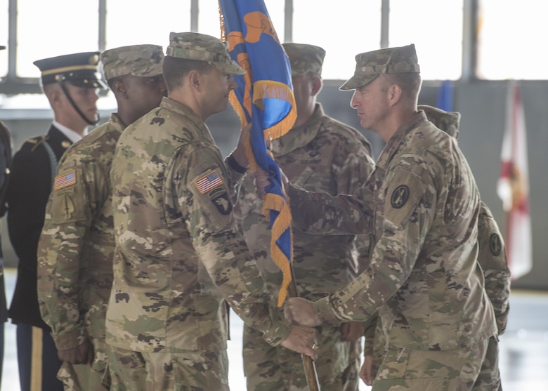 U.S. Army Priority Air Transport Command leadership passes the unit guidon during a change of command and responsibility ceremony at Joint Base Andrews, Md., July 14, 2017. The role of commander was passed from Lt. Col. Heather L. Maki to Lt. Col. Matthew L. Rowland during the event. Change of command ceremonies are symbolic of the transfer of command responsibility and the lasting continuity of the unit's mission. (U.S. Air Force photo by Senior Airman Jordyn Fetter)