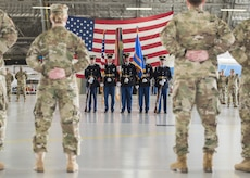 U.S. Army color guard members stand in Hangar Two during the U.S. Army Priority Air Transport Command change of command and responsibility ceremony at Joint Base Andrews, Md., July 14, 2017. The colors are a symbol of the commander's authority and are a reminder of the responsibility they have to execute the unit's mission and care for its personnel and equipment. The role of commander was passed from Lt. Col. Heather L. Maki to Lt. Col. Matthew L. Rowland during the event. (U.S. Air Force photo by Senior Airman Jordyn Fetter)