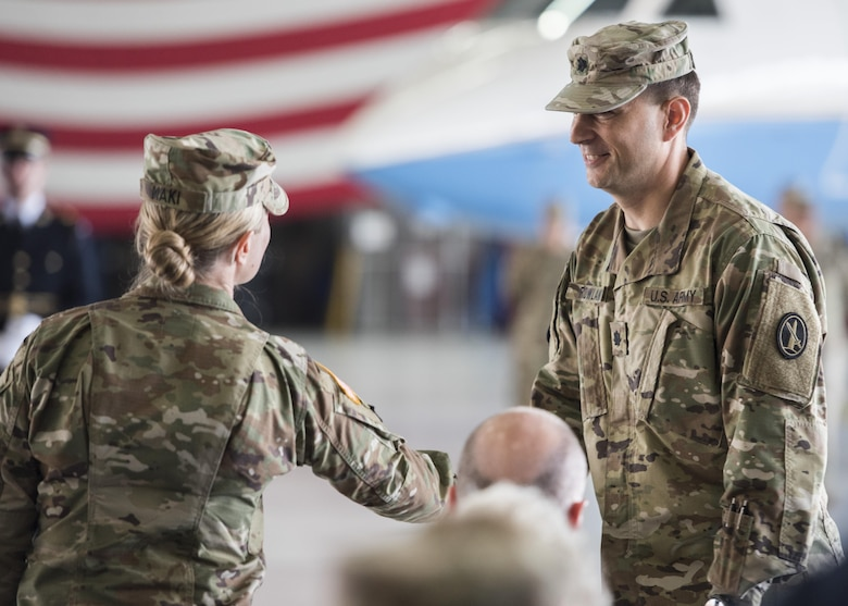Lt. Col. Heather L. Maki, left, former U.S. Army Priority Air Transport Command commander, welcomes Lt. Col. Matthew L. Rowland, right, incoming USAPAT commander, during the unit's change of command and responsibility ceremony at Joint Base Andrews, Md., July 14, 2017. USAPAT's mission is to provide senior Army leadership and key government officials with fast, long-range and professional executive transportation throughout the world. Change of command ceremonies are symbolic of the transfer of command responsibility and the lasting continuity of the unit's mission. (U.S. Air Force photo by Senior Airman Jordyn Fetter)