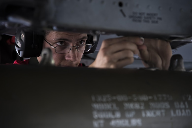 Staff Sgt. Christopher Carlson, 75th Aircraft Maintenance Unit weapons load team chief, loads a GBU-12 joint direct attack munition during weapons load crew competition, July 14, 2017, at Moody Air Force Base, Ga. Every quarter members of the 74th and 75th AMU competes in the quarterly competition that tests knowledge, dress and appearance, and speed of loading a GBU-12 joint direct attack munition and AIM-9 Sidewinder. (U.S. Air Force photo by Staff Sgt. Eric Summers Jr.)