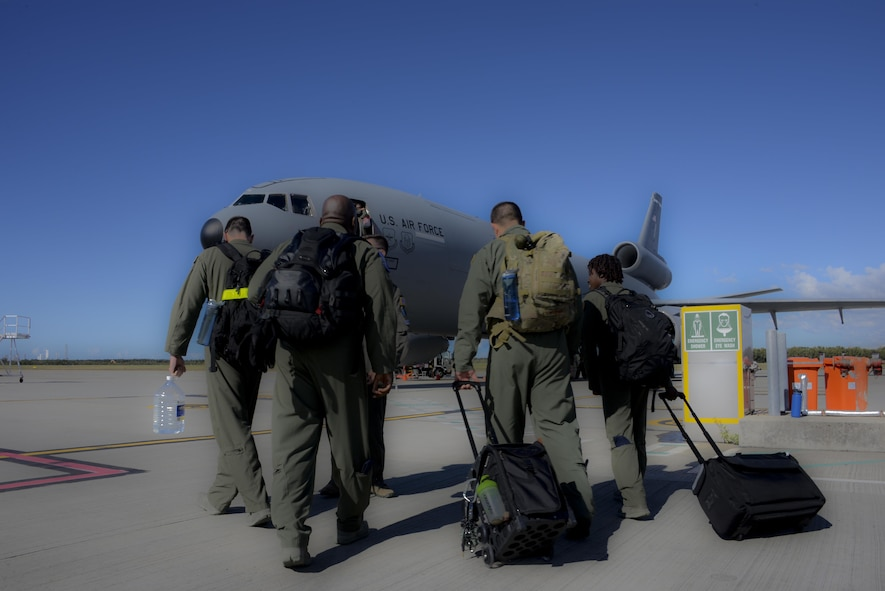 Aircrew from the 6th and 9th Air Refueling Squadrons board a KC-10 Extender at Royal Australian Air Force Base Richmond in Brisbane, Australia July 14, 2017. KC-10s from Travis AFB and Joint Base McGuire-Dix-Lakehurst, New Jersey, supported Exercise Talisman Saber 2017 by executing Exercise Ultimate Reach, a strategic refueling and airdrop mission in which three KC-10s refueled five C-17 Globemaster IIIs carrying U.S. Army, Australian and Canadian paratroopers prior to an airdrop. TS17 is a biennial exercise in Australia that focuses on bilateral military training between U.S. Pacific Command forces and the Australian Defence Force to improve U.S.-Australia combat readiness, increase interoperability, maximize combined training opportunities and conduct maritime prepositioning and logistics operations in the Pacific. (U.S. Air Force photo by 2nd Lt. Sarah Johnson)