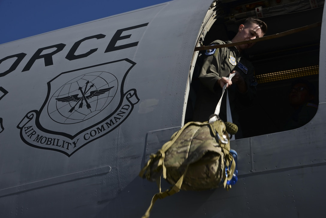 Airman 1st Class Patrick Tracy, 6th Air Refueling Squadron boom operator, loads aircrew equipment onto a KC-10 Extender at Royal Australian Air Force Base Richmond in Brisbane, Australia July 14, 2017. KC-10s from Travis AFB and Joint Base McGuire-Dix-Lakehurst, New Jersey, supported Exercise Talisman Saber 2017 by executing Exercise Ultimate Reach, a strategic refueling and airdrop mission in which three KC-10s refueled five C-17 Globemaster IIIs carrying U.S. Army, Australian and Canadian paratroopers prior to an airdrop. TS17 is a biennial exercise in Australia that focuses on bilateral military training between U.S. Pacific Command forces and the Australian Defence Force to improve U.S.-Australia combat readiness, increase interoperability, maximize combined training opportunities and conduct maritime prepositioning and logistics operations in the Pacific. (U.S. Air Force photo by 2nd Lt. Sarah Johnson)