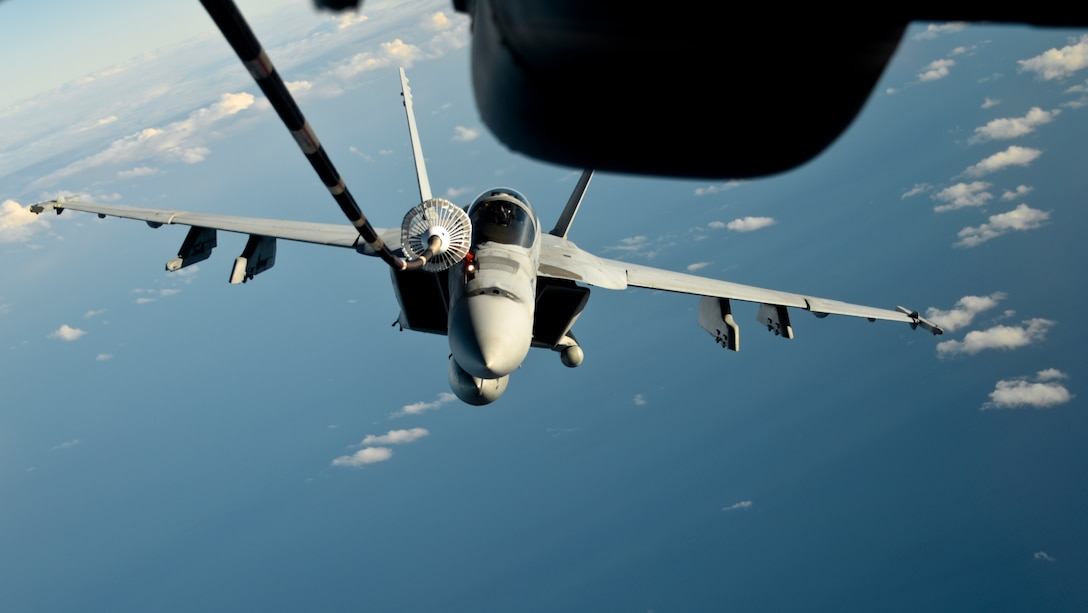 A KC-10 Extender from Travis Air Force Base, California, refuels a U.S. Navy F/A-18 Super Hornet over the Pacific Ocean July 14, 2017. KC-10s from Travis AFB supported Exercise Talisman Saber 2017 by conducting various air refueling missions over Australia. TS17 is a biennial exercise in Australia that focuses on bilateral military training between U.S. Pacific Command forces and the Australian Defence Force to improve U.S.-Australia combat readiness, increase interoperability, maximize combined training opportunities and conduct maritime prepositioning and logistics operations in the Pacific. (U.S. Air Force photo by 2nd Lt. Sarah Johnson)